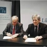 Julián García Valverde y Enrique Barón durante la firma del convenio entre la Fundación Gregorio Peces-Barba y la FYME.