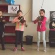 Violines por la paz sonando en El Prat