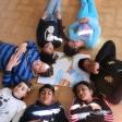 Niños y niñas del CEIP La Paz de Plasencia (Cáceres), compartiendo el retrato de Yehudi Menuhin con su violín